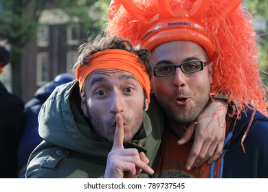 Amsterdam, The Netherlands - April 30, 2013: Interesting peoples at the celebrations of ( Koninginnedag ) Queen\'s Day is a national holiday in the Kingdom of the Netherlands .