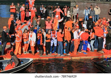 Amsterdam, The Netherlands - April 30, 2013: Celebrations of ( Koninginnedag ) Queen\'s Day is a national holiday in the Kingdom of the Netherlands . Queen's Day  is  the day of national unity.
