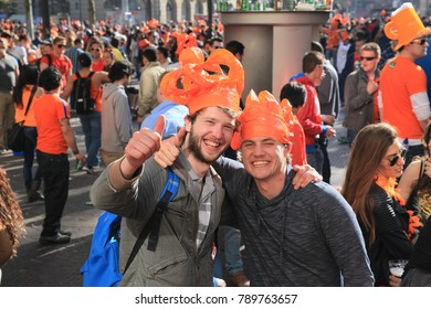 Amsterdam, The Netherlands - April 30, 2013: Celebrations of ( Koninginnedag ) Queen's Day is a national holiday in the Kingdom of the Netherlands . Queen's Day  is  the day of national unity.