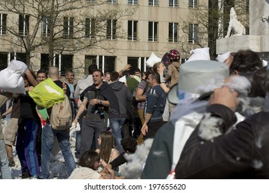 Amsterdam, The Netherlands - April 5, 2014: The Massive pillow fight took place on Dam square in the centre of Amsterdam on 5th April.