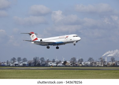AMSTERDAM, THE NETHERLANDS - APRIL, 8. The Austrian Airlines Fokker 100 with identification OE-LVM lands at Amsterdam Airport Schiphol (The Netherlands, AMS), Polderbaan on April 8, 2016.