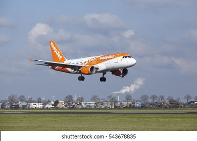 AMSTERDAM, THE NETHERLANDS - APRIL, 8. The Easyjet (Amsterdam livery) Airbus A319 with identification G-EZDN lands at Amsterdam Airport Schiphol (The Netherlands, AMS), Polderbaan on April 8, 2016.