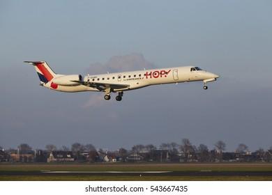 AMSTERDAM, THE NETHERLANDS - APRIL, 8. The HOP! Embraer ERJ-145MP with identification F-GUBG lands at Amsterdam Airport Schiphol (The Netherlands, AMS), Polderbaan on April 8, 2016.