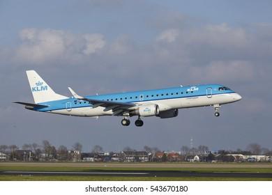 AMSTERDAM, THE NETHERLANDS - APRIL, 8. The KLM Cityhopper Embraer ERJ-190STD with identification PH-EXA lands at Amsterdam Airport Schiphol (The Netherlands, AMS), Polderbaan on April 8, 2016.