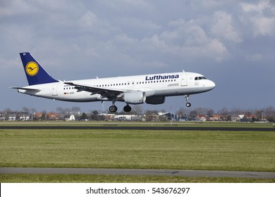 AMSTERDAM, THE NETHERLANDS - APRIL, 8. The Lufthansa Airbus A320-214 with identification D-AIZD lands at Amsterdam Airport Schiphol (The Netherlands, AMS), Polderbaan on April 8, 2016.