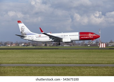 AMSTERDAM, THE NETHERLANDS - APRIL, 8. The Norwegian (Anton K.H. Jakobsen Livery) Boeing 737-8IP with identification  LN-NGT lands at Schiphol (The Netherlands, AMS), Polderbaan on April 8, 2016.