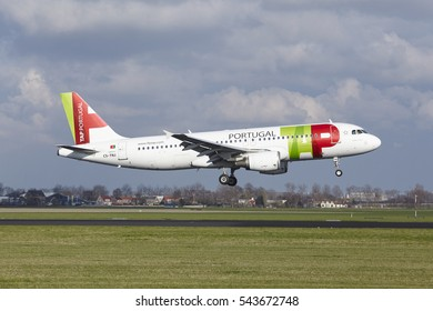 AMSTERDAM, THE NETHERLANDS - APRIL, 8. The TAP Portugal Airbus A320-214 with identification CS-TNJ lands at Amsterdam Airport Schiphol (The Netherlands, AMS), Polderbaan on April 8, 2016.