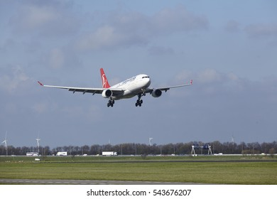 AMSTERDAM, THE NETHERLANDS - APRIL, 8. The Turkish Airlines Airbus A330-203 with identification TC-JIL lands at Amsterdam Airport Schiphol (The Netherlands, AMS), Polderbaan on April 8, 2016.