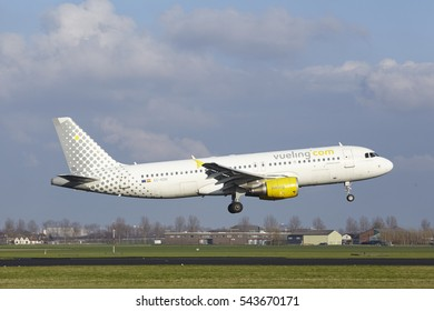 AMSTERDAM, THE NETHERLANDS - APRIL, 8. The Vueling Airbus A320-214 with identification EC-KDH lands at Amsterdam Airport Schiphol (The Netherlands, AMS), Polderbaan on April 8, 2016.