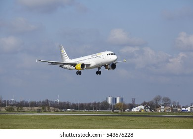 AMSTERDAM, THE NETHERLANDS - APRIL, 8. The Vueling Airbus A320-214 with identification EC-LOP lands at Amsterdam Airport Schiphol (The Netherlands, AMS), Polderbaan on April 8, 2016.