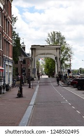 Amsterdam, the Netherlands - August 03, 2017: Walter Süskindbrug on Amsel in Amsterdam with view on the Magere Brug, visiting the city of Amsterdam, Holland, Netherland