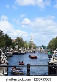 Amsterdam, the Netherlands - August 03, 2017: View from Magere Brug, Kerkstraat - Visiting the city of Amsterdam, Holland, Netherlands