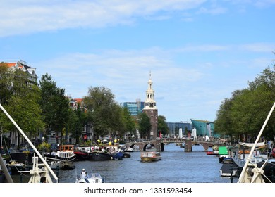 Amsterdam, the Netherlands - August 05, 2017: View from Magere Brug, Kerkstraat - Visiting the city of Amsterdam, Holland, the Netherlands