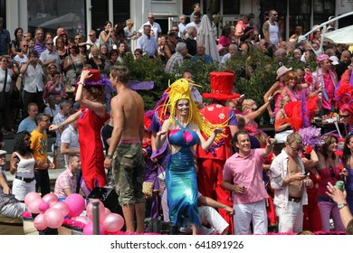 Amsterdam, Netherlands - August 1, 2009: Nice people dancing on the boat. Gay parade in Amsterdam, the Netherlands.