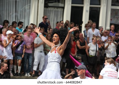 Amsterdam, Netherlands - August 1, 2009: Interesting person dancing on the boat. Gay parade in Amsterdam, the Netherlands.