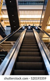 Amsterdam, Netherlands - August 1, 2016: Low angle view of escalators of the lobby of Magna Plaza Shopping Center in Amsterdam.  Indoor view