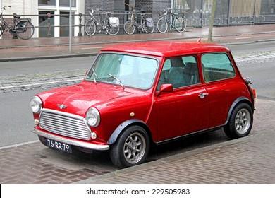 AMSTERDAM, NETHERLANDS - AUGUST 10, 2014: Retro car Austin Mini Cooper at the city street.