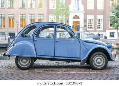 AMSTERDAM, NETHERLANDS - AUGUST 12, 2016: Citroen 2CV Special in blue celeste parked along the canals of Amsterdam