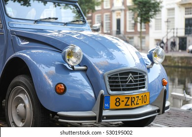 AMSTERDAM, NETHERLANDS - AUGUST 12, 2016: Citroen 2CV Blue Celeste in mint condition parked along the canals of Amsterdam