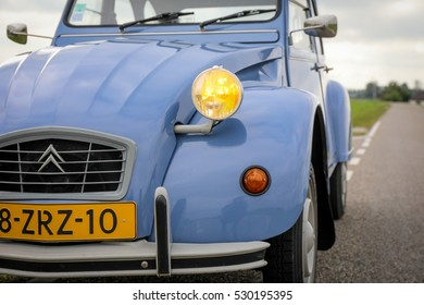 AMSTERDAM, NETHERLANDS - AUGUST 12, 2016: Citroen 2CV in the color Blue Celeste with yellow headlights parked outside.