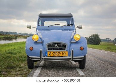 AMSTERDAM, NETHERLANDS - AUGUST 12, 2016: Front picture of a Citroen 2CV Special from 1990 with yellow headlights.