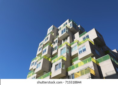 AMSTERDAM, NETHERLANDS - AUGUST 12, 2017: A modern architure skyscaper in the Zuidas in Amsterdam in summer with a blue sky