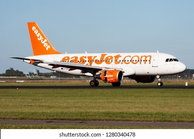AMSTERDAM / NETHERLANDS - AUGUST 13, 2014: EasyJet Airbus A319 G-EZFO passenger plane taxiing at Amsterdam Schipol Airport