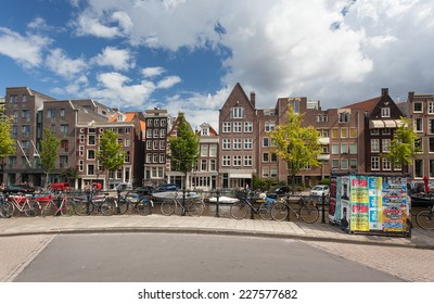 AMSTERDAM - NETHERLANDS: AUGUST 13, 2014: Bicycles parked on the bridge over canal.