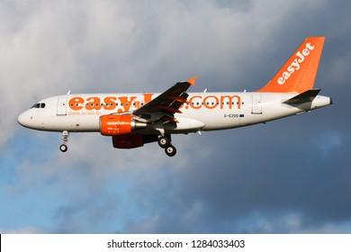 AMSTERDAM / NETHERLANDS - AUGUST 14, 2014: EasyJet Airbus A319 G-EZDD passenger plane landing at Amsterdam Schipol Airport
