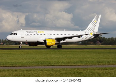 AMSTERDAM / NETHERLANDS - AUGUST 15, 2014: Vueling Airbus A320 EC-HQJ passenger plane departure at Amsterdam Schipol Airport