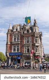 AMSTERDAM, NETHERLANDS - AUGUST 16, 2013: Typical traditional Dutch architecture building in Amsterdam in summer of 2013.
