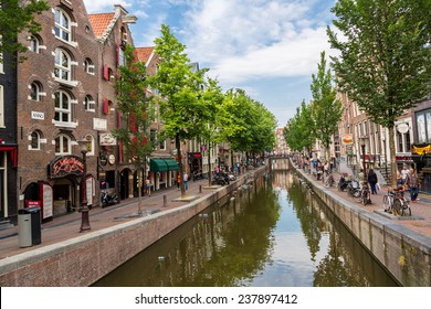 AMSTERDAM, NETHERLANDS - AUGUST 19: Red light district in Amsterdam. Amsterdam is the capital and most populous city of the Netherlands on August 19, 2014