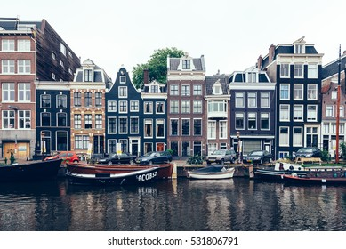 Amsterdam, Netherlands - August 2, 2016: Street in historical city center of Amsterdam. It is one of the most romantic and beautiful cities in Europe.  Amsterdam is a city of tolerance and diversity.