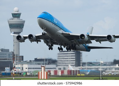 AMSTERDAM, THE NETHERLANDS, AUGUST 20 2016: A KLM Boeing 747 passenger plane is taking off from the runway at Schiphol.