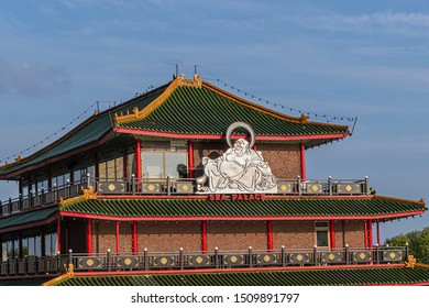AMSTERDAM, NETHERLANDS - AUGUST 21, 2019: Amsterdam excellent Sea Palace Restaurant (1984) - 3-story floating pagoda-style restaurant on Lake IJ. Sea Palace is the first floating restaurant in Europe.