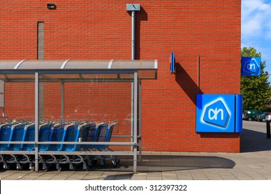 Amsterdam, The Netherlands - August 22, 2015: Albert Heijn Store front with logo and shopping carts, Albert Heijn is the largest supermarket chain stores in Holland