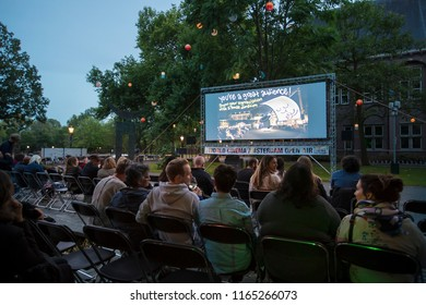Amsterdam, The Netherlands - August 22 2018: open air screening of Cuban film Sergio and Serguei at De Troppen garden during World Cinema Amsterdam, a world film festival held from 16 to 25/08/2018