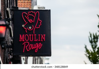 AMSTERDAM, NETHERLANDS - AUGUST 22: club Moulin Rouge in the red light district on August 22, 2015 in Amsterdam. The district is world reknown and famous attraction for tourists.