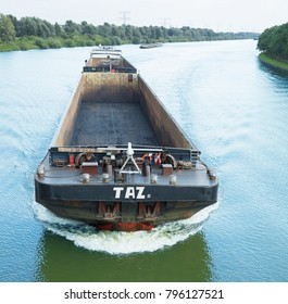 AMSTERDAM, THE NETHERLANDS - AUGUST 23, 2017: Unloaded cargo boat Taz, built in 2000, on the Amsterdam - Rhine Canal. The canal connects Amsterdam to the Ruhr area in Germany and is 59 km long.