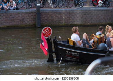 AMSTERDAM, NETHERLANDS - AUGUST 25, 2017:  Small rental boat for tourists in the dutch capital