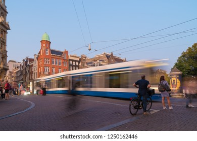 AMSTERDAM, NETHERLANDS - AUGUST 25, 2017: Tram crossing a bridge showing blurred motion in the Dutch capital