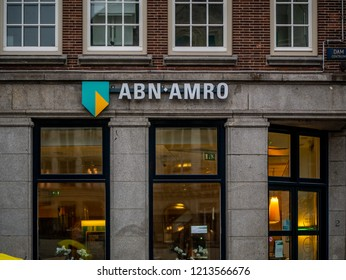 Amsterdam, Netherlands - August 26, 2018: Brand name logo ABN AMRO bank on local branch office in Amsterdam