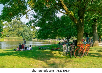 Amsterdam, The Netherlands - August 27, 2016: Vondelpark a favorite place for rest and walking residents and tourists. The park has good infrastructure for cyclists.