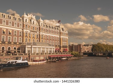 Amsterdam, Netherlands - August 3, 2013: A vintage color tone picture of the world famous amstel hotel, as seen from the Amstel river.