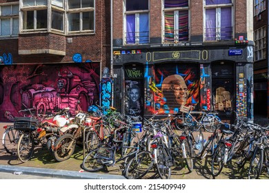 Amsterdam,  Netherlands - August 3, 2014: bicycles on the streets and graffiti on the walls of Amsterdam. Features of the Dutch capital.