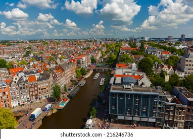 Amsterdam, Netherlands - August 5, 2014: Canal Prinsengracht and Anne Frank House of Amsterdam. City view from the bell tower of the church Westerkerk, Holland, Netherlands.
