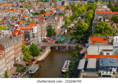 Amsterdam, Netherlands - August 5, 2014: Canal Prinsengracht and houses of Amsterdam. City view from the bell tower of the church Westerkerk, Holland, Netherlands.