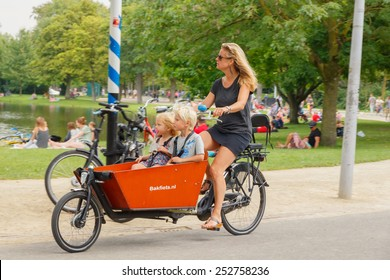 Amsterdam, Netherlands - August 5, 2014: Bicyclists in Amsterdam.
