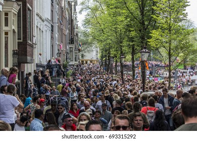 AMSTERDAM, THE NETHERLANDS - AUGUST 5,2017: Boats with dancers float in the canal at the famous Canal Parade of the Amsterdam Gay Pride on August 5,2017 in Amsterdam , Holland