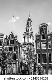 AMSTERDAM, NETHERLANDS - AUGUST 6, 2016: Famous buildings of Amsterdam city centre close-up. General landscape view of city streets and traditional Dutch architecture. Amsterdam - Netherlands.